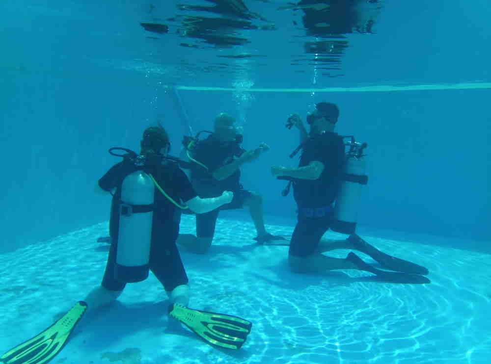 New divers in training with Steven from Phuket dash Scuba in a swimming pool.